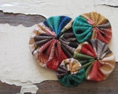 yo-yo flower fascinator, handmade.  april showers