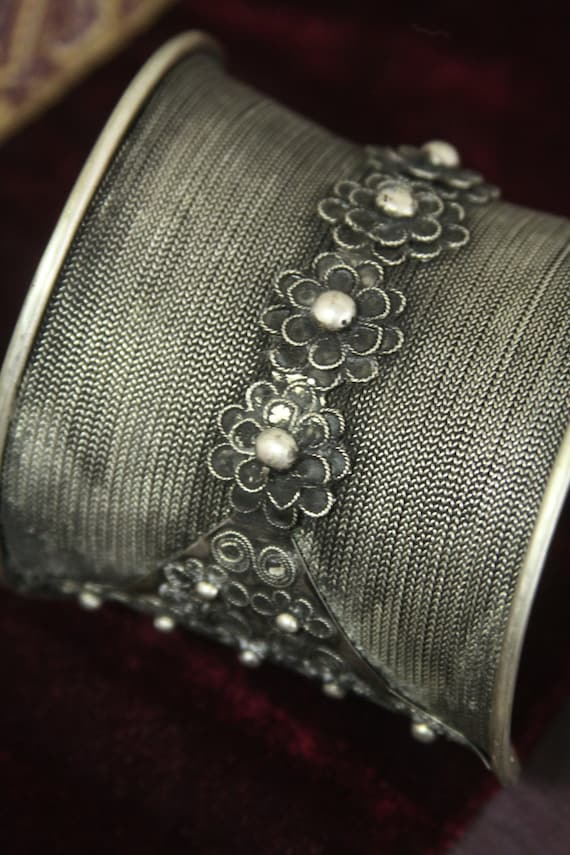 Tribal silver cuff bracelet -- flaired shape with braided wire and flower silver work -- nice patina  FREE SHIPPING SALE