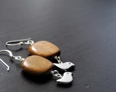 wooden square with silver bird