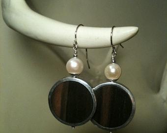 framed black ebony and pearl earrings