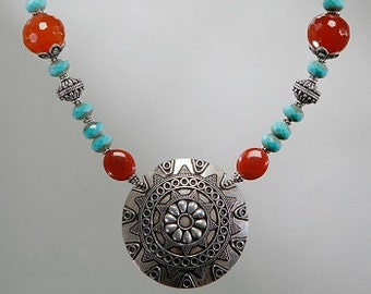 Turquoise and carnelian necklace with large Bali silver centerpiece