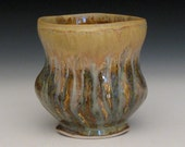 orange and black temmoku cup with gold luster