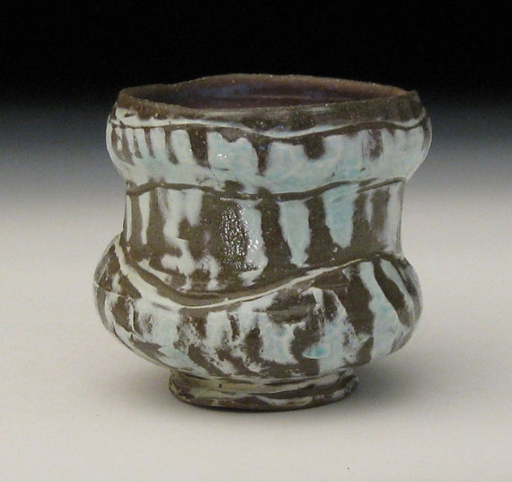 earthenware whiskey cup