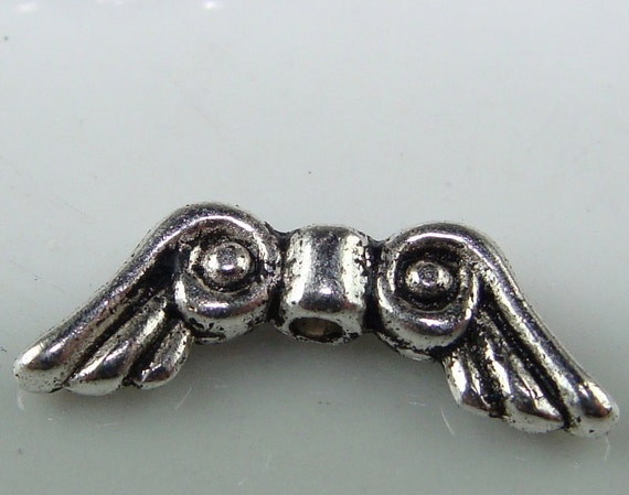 10 Small Scrolled Angel Wing Beads Silver 14mm (41103)