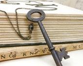 Skeleton key necklace with large rusty grunge soot black key