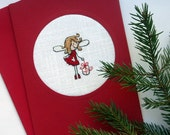 embroidered cross stitch Christmas card with little angel, red and white