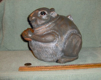 Very Cute Fatty Squirrel Holding An Acorn Made of Ceramic