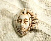 faux ivory face pendant with geometric ornament