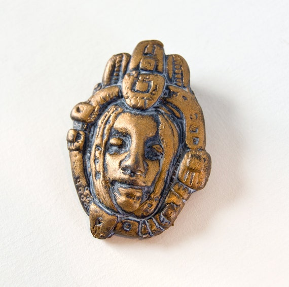 Metallic Gold/Bronze Face Pendant with Rectangle Crown