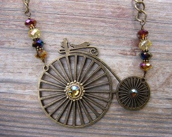 Old Fashioned Bicycle Brass and Crystal Necklace