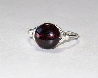 Beautiful little sterling silver and Garnet wire wrapped ring