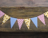 a mini banner... red and yellow and blue, checked and dotted with a cherry on top