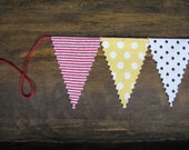 a mini banner... red and yellow, striped and dotted