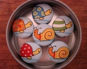 Colorful Turtles and Snail Magnets on Blue