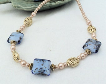Blue and gold metallic pillow bead necklace.