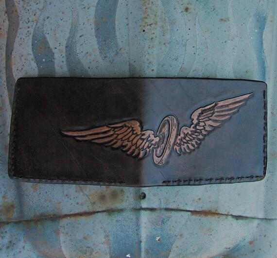 Rode Hard 'n Put Up Wet Wallet