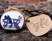 Grasshopper stamp on plum wood