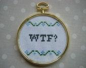 WTF - cross-stitch in a circular frame