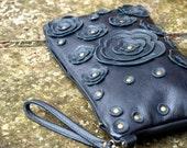 Black Leather  Wristlet . Black Studded Floral Applique