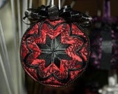 Quilted ornament in red and black