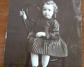 Photograph of Girl on chair by Greber