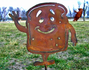 Whimsical garden art - Happy toast man - Metal garden stake - Cheerful character - Outdoor home decor - Rustic humor - Flowerbed accent