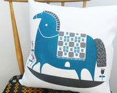 rocking horse cushion in teal on white linen