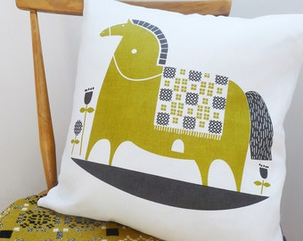 rocking horse cushion in olive on white linen