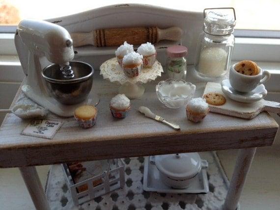 Miniature shabby baking cupcakes table