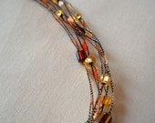 Copper ribbon and bead necklace