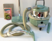 1950s General Electric canister swivel top vacuum cleaner with all attachments