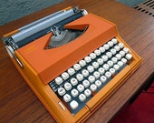 Reserved for Kathy - Orange Olivetti Typewriter PROFESSIONALLY SERVICED including new rubber platten