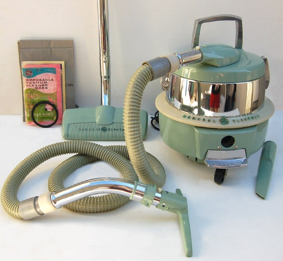 1950s General Electric Canister Swivel Top Vacuum Cleaner With