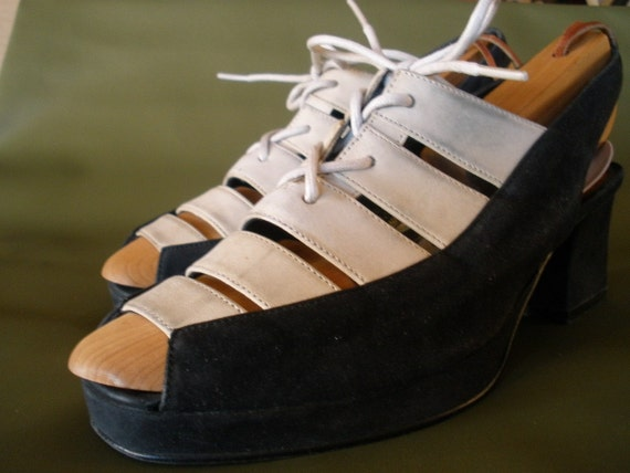 reserved-size 7 black and white sporty platforms