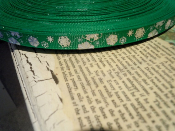 Christmas Metallic Silver Foil Snowflakes on green grosgrain sold by the yard