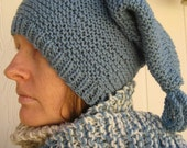Hand knitted blue stocking cap and multitonal blue, cream, and tan ladder scarf set