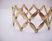 Gold toned vintage bracelet. Accordion style. Stretch. Patina cuff. Women's jewelry.