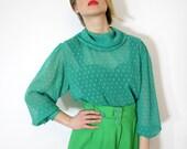 Vintage shirt. sheer green back buttoning. size L