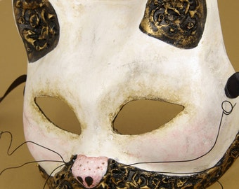 Le Chat (The Cat) Mask, Cream cat shaped eyemask with 3D swirls, gold gilding, and wire whiskers