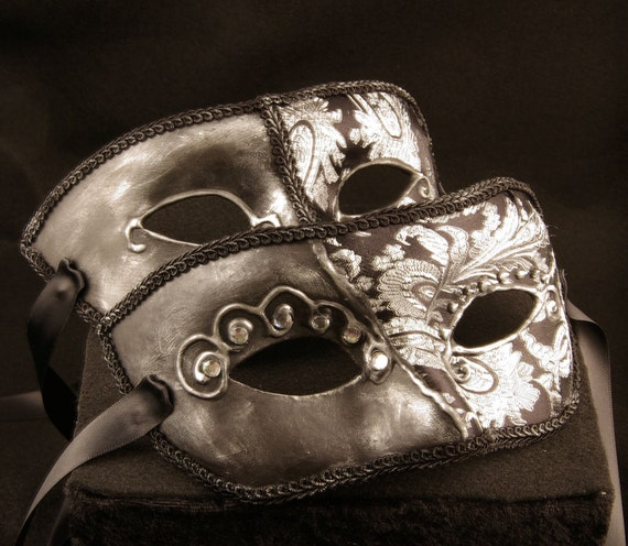 Scuro Coppia Paired masks, male and female silver brocade covered paper mache masquerade masks