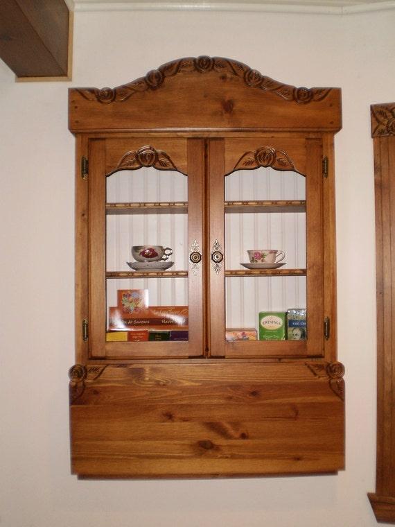 Drop down cupboard, cabinet.
