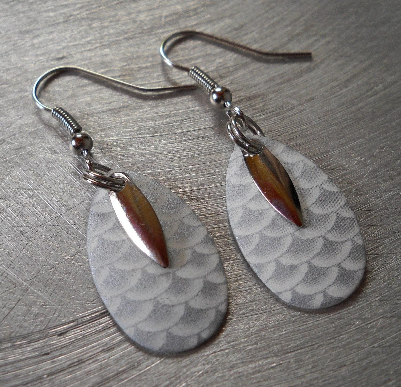 items similar to silver glow in the dark earrings