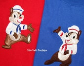 Zip the chipmunk ready for a cruise in his sailor suit appliqued on a royal blue short sleeved tshirt children and adult sizes
