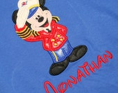 Mm Cruise Director appliqués on a short sleeved tee children and adult sizes