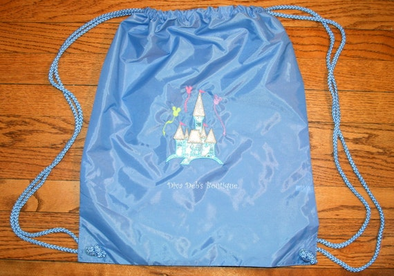 Magical castle appliqued on a cinch string backpack you pick color of backpack