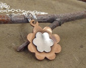 Copper and sterling silver flower charm necklace on sterling silver chain