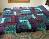 afghan blanket throw in purple and turquoise made from recycled sweater knits.