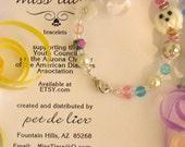 Reserve for Monica - pretty Miss Tiara dog theme gift pack bracelet book mark etc