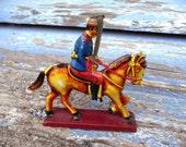 Tin toy horseman soldier