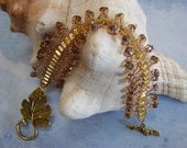 Gold Tone Leaf Toggle Seed Bead Bracelet